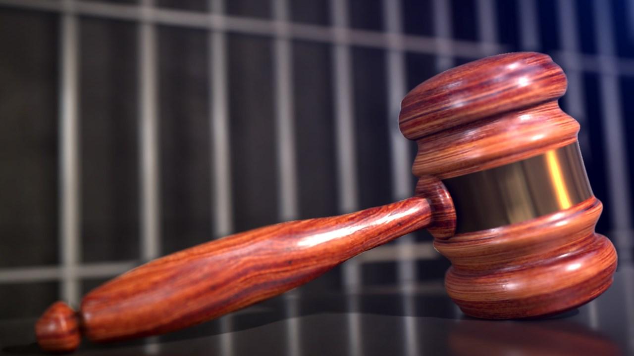 gavel and jail bars