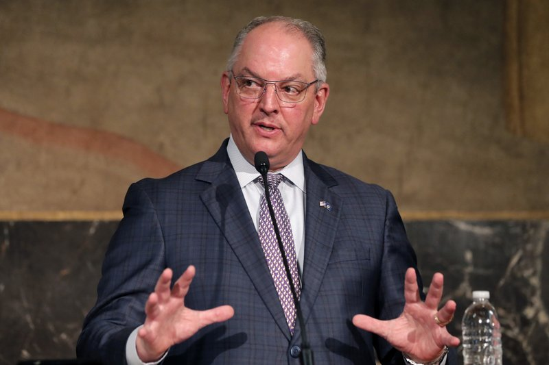 Louisiana Gov. John Bel Edwards speaks to reporters at a briefing on the state's efforts against the coronavirus pandemic in Baton Rouge, La., Monday, May 4, 2020. (AP Photo/Gerald Herbert)