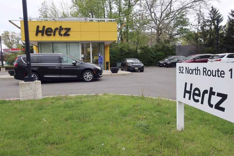 FILE - In this May 6, 2020, file photo, a Hertz car rental is closed during the coronavirus pandemic in Paramus, N.J. Hertz filed for bankruptcy protection Friday, May 22, 2020, unable to withstand the pandemic that has crippled global travel and with it, the heavily indebted 102-year-old car rental company's business. (AP Photo/Ted Shaffrey, File)