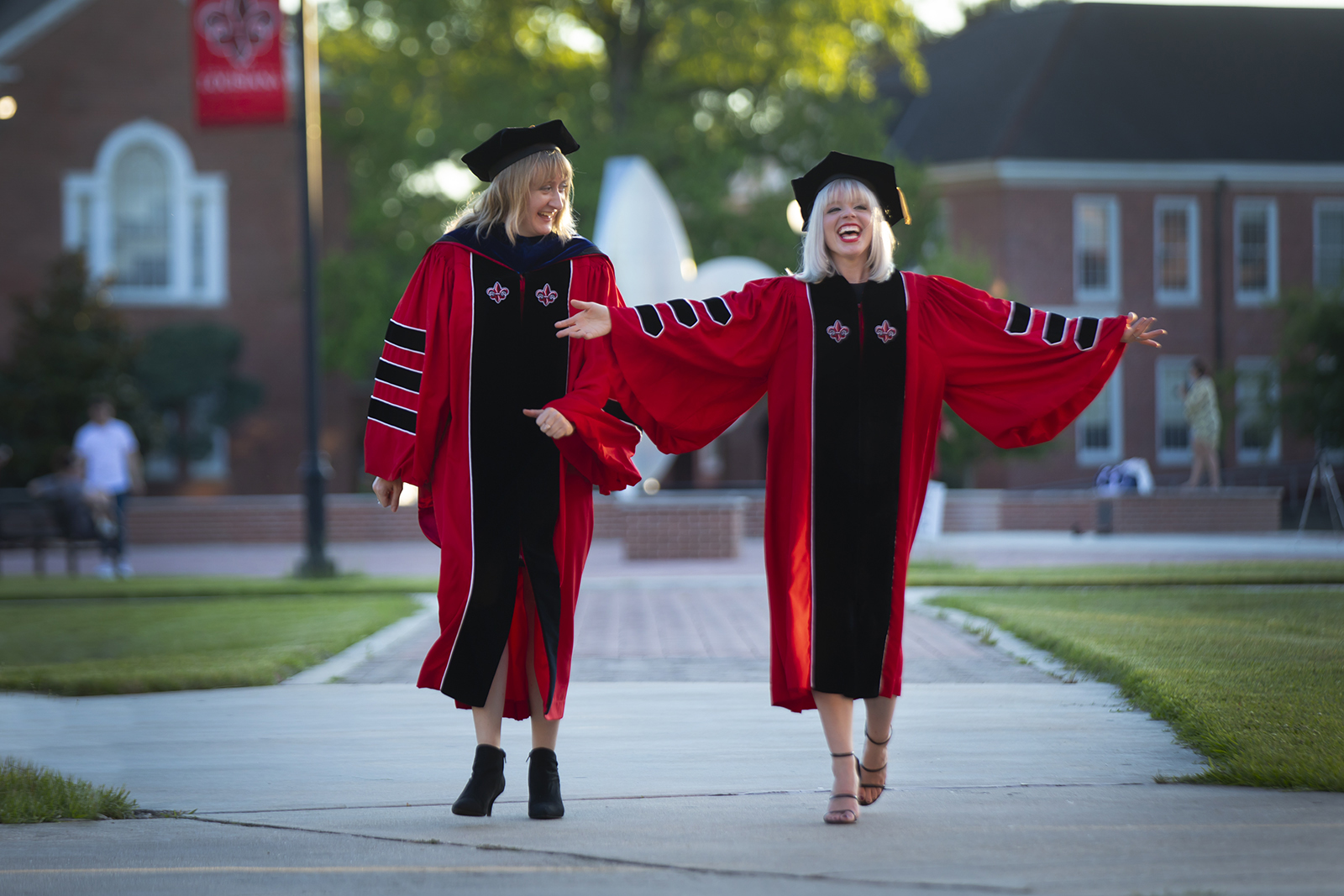 Patti Jeane Pangborn, left, and Samantha Castleman were among a record 1,173 women who received degrees Friday from the University of Louisiana at Lafayette. Both, seen here in the University's Quadrangle in the days leading up to Friday's virtual Commencement, completed doctoral degrees in English. (Photo credit: Doug Dugas / University of Louisiana at Lafayette)