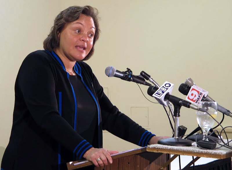 FILE - In this Monday, Feb. 10, 2014, file photo, state Sen. Karen Carter Peterson, chair of the Louisiana Democratic Party, speaks to the Baton Rouge Press Club, in Baton Rouge, La. Peterson announced Thursday, July 9, 2020, that she won't seek reelection as chair of the Louisiana Democratic Party. (AP Photo/Melinda Deslatte, File)