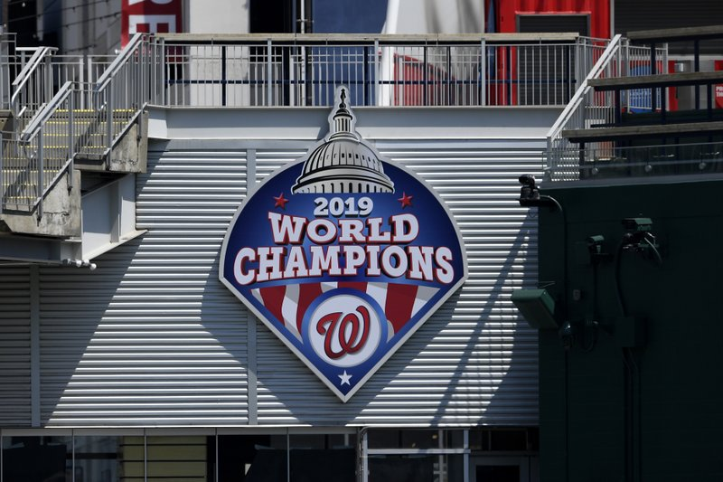 A 2019 World Series champions sign is displayed during the Washington Nationals baseball practice at Nationals Park, Wednesday, July 22, 2020, in Washington. (AP Photo/Nick Wass)