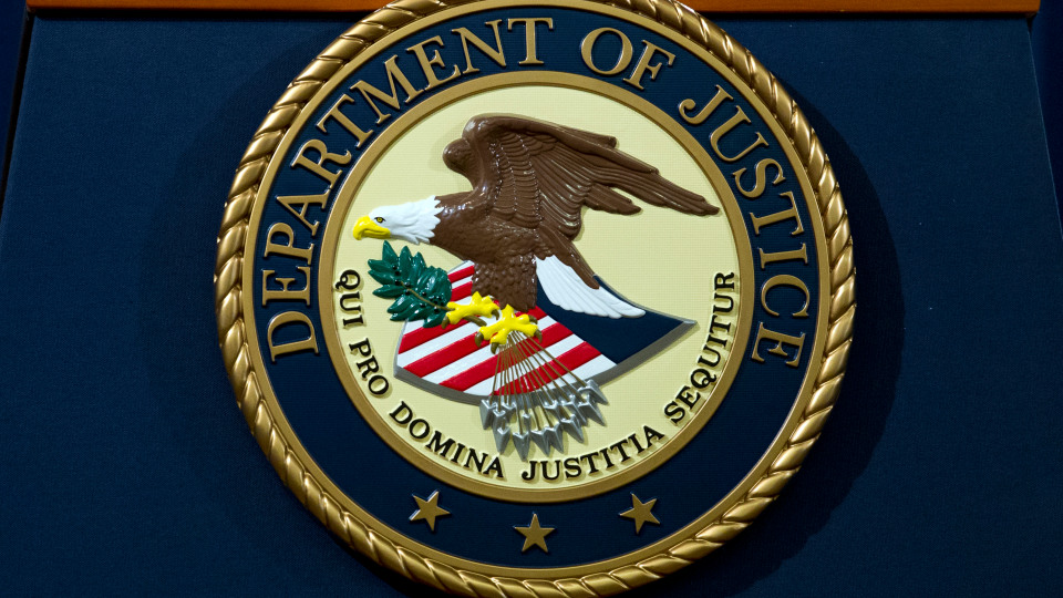 FILE – In this Nov. 28, 2018, file photo, the Department of Justice seal is seen in Washington, D.C. (AP Photo/Jose Luis Magana, File)