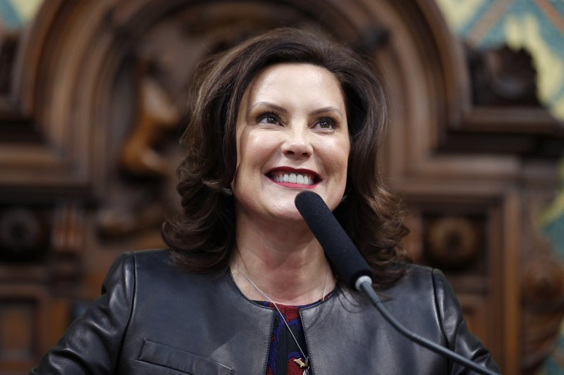 FILE - In this Jan. 29, 2020, file photo, Michigan Gov. Gretchen Whitmer delivers her State of the State address to a joint session of the House and Senate, at the state Capitol in Lansing, Mich. (AP Photo/Al Goldis, File)