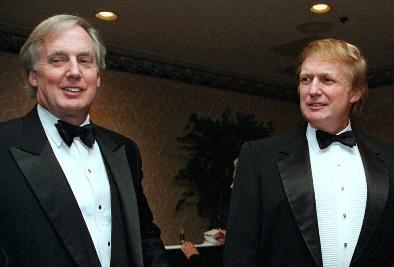 FILE - In this Nov. 3, 1999 file photo, Robert Trump, left, joins then real estate developer and presidential hopeful Donald Trump at an event in New York. President Donald Trump's younger brother, Robert Trump, has been hospitalized in New York, according to the White House. The president is expected to visit his 72-year-old brother at a hospital in Manhattan on Friday. (AP Photo/Diane Bonadreff, File)