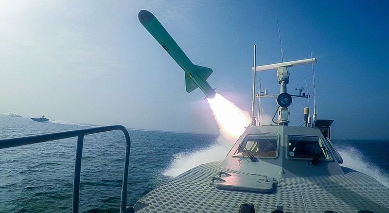 "In this photo released Tuesday, July 28, 2020, by Sepahnews, a Revolutionary Guard's speed boat fires a missile during a military exercise. Iranian commandos also fast-roped down from a helicopter onto a replica of an aircraft carrier in the exercise called ""Great Prophet 14."" The drill appears aimed at threatening the U.S. amid tensions between Tehran and Washington. (Sepahnews via AP)"