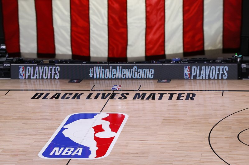 An empty court and bench are shown following the scheduled start time of Game 5 of an NBA basketball first-round playoff series, Wednesday, Aug. 26, 2020, in Lake Buena Vista, Fla. All three NBA playoff games scheduled for Wednesday were postponed, with players around the league choosing to boycott in their strongest statement yet against racial injustice. (Kevin C. Cox/Pool Photo via AP)