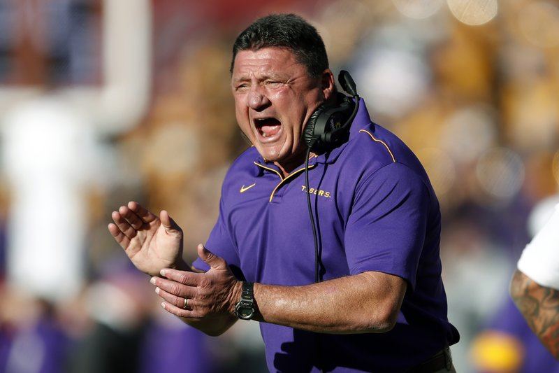 FILE - In this Saturday, Nov. 9, 2019 file photo, LSU head coach Ed Orgeron reacts after a LSU touchdown in the first half of an NCAA football game against Alabama in Tuscaloosa, Ala. This is the rare SEC team whose schedule might have gotten a tad easier by playing a conference-only slate. The SEC opponents added to LSU's schedule last month were Missouri (6-6 last season) and Vanderbilt (3-9). LSU had to drop a scheduled home date with No. 14 Texas, though its other non-conference games would have been lackluster matchups with Rice, Nicholls and Texas-San Antonio. (AP Photo/John Bazemore, File)