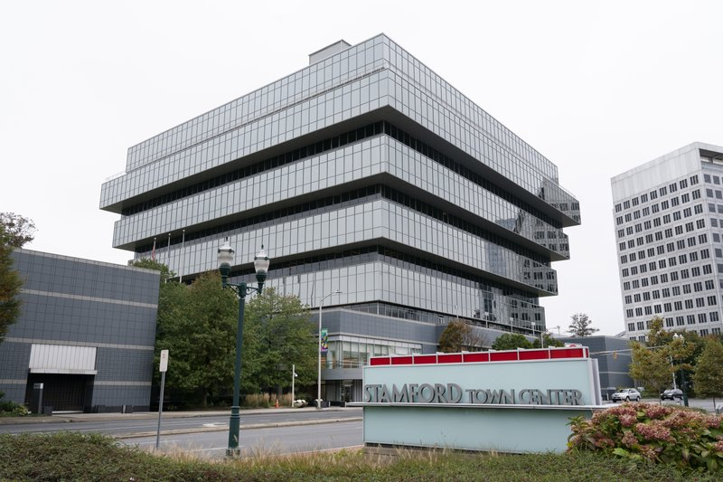 This Wednesday, Oct. 21, 2020 photo shows Purdue Pharma headquarters in Stamford, Conn. The Justice Department says on Wednesday, Purdue Pharma, the company that makes OxyContin, will plead guilty to three federal criminal charges as part of a settlement of more than $8 billion. OxyContin is the powerful prescription painkiller that experts say helped touch off an opioid epidemic. (AP Photo/Mark Lennihan)