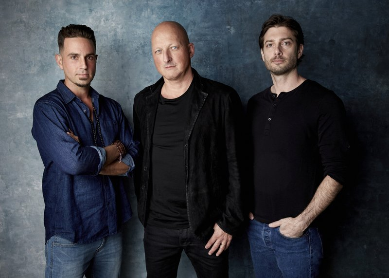 "FILE - James Safechuck, from right, director Dan Reed and Wade Robson pose for a portrait to promote the film ""Leaving Neverland"" during the Sundance Film Festival on Jan. 24, 2019, in Park City, Utah. A Los Angeles judge has dismissed the lawsuit of one of two men who alleged that Michael Jackson abused them as boys in the documentary ""Leaving Neverland."" Judge Mark Young ruled on Tuesday, Oct. 20, 2020, that 42-year-old Safechuck couldn't sue the two corporations Jackson owned that are named as defendants. The similar lawsuit of fellow accuser Robson, which was also revived by the appeals court, remains alive. (Photo by Taylor Jewell/Invision/AP, File)"