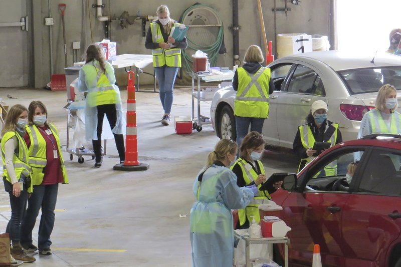 This 2020 photo provided by Carlton County shows their drive-thru flu clinic in Carlton, Minn. The facility is a way to social distance in the coronavirus pandemic, but also served as a test run for the COVID-19 vaccines that county health officials still know little about. (Jared Hovi/Carlton County GIS via AP)