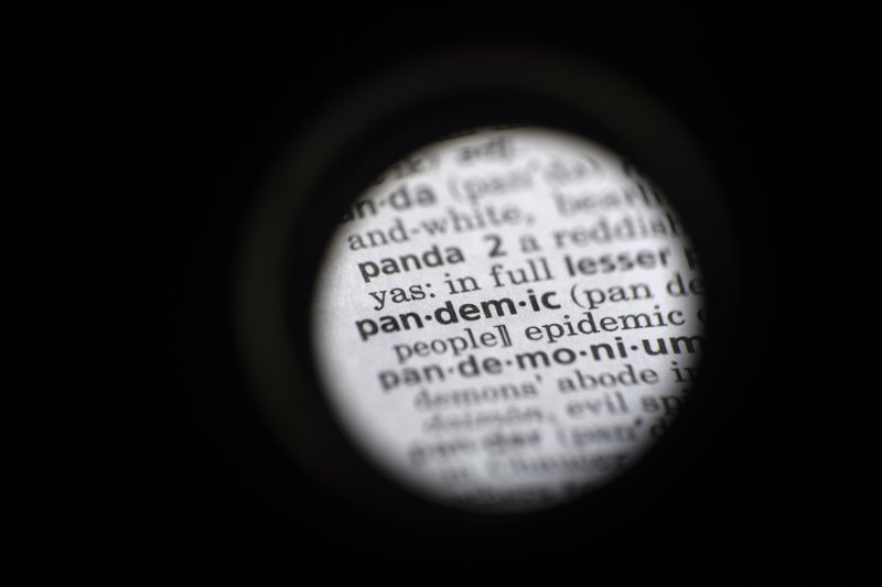 "In this Saturday, Nov. 21, 2020, photo taken through a camera lens the word ""pandemic"" in seen in a dictionary in Washington. Dictionary.com declared ""pandemic"" its 2020 word of the year. (AP Photo/Jenny Kane)"
