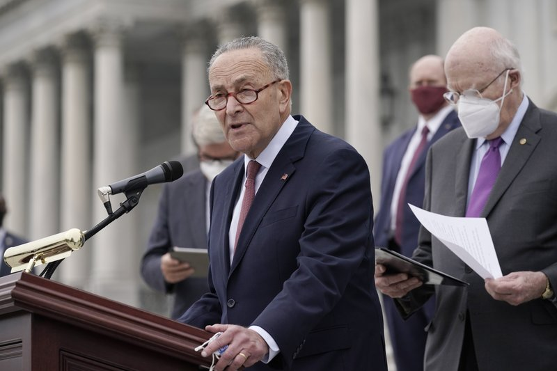FILE - In this Oct. 22, 2020, file photo Senate Minority Leader Chuck Schumer, D-N.Y., and Democratic members of the Senate Judiciary Committee hold a news conference after boycotting the vote by the Republican-led panel to advance the nomination of Judge Amy Coney Barrett to sit on the Supreme Court at the Capitol in Washington. Schumer, will be majority leader once the two new Georgia senators and Vice President-elect Kamala Harris are all sworn into office, and will have the opportunity to bring legislation to the floor and force votes. (AP Photo/J. Scott Applewhite, File)
