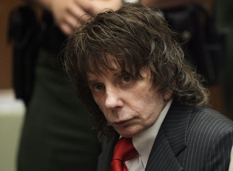 """FILE - In this May 29, 2009 file photo, music producer Phil Spector sits in a courtroom for his sentencing in Los Angeles. Spector, the eccentric and revolutionary music producer who transformed rock music with his """"Wall of Sound"""" method and who was later convicted of murder, died Saturday, Jan. 16, 2021, at age 81. (AP Photo/Jae C. Hong, Pool, File)"""