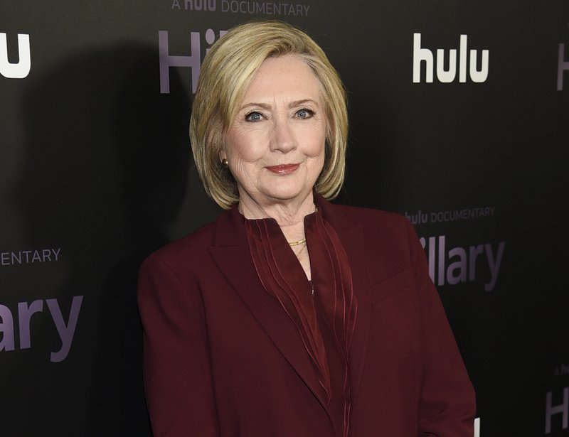 "FILE - Former secretary of state Hillary Clinton attends the premiere of the Hulu documentary ""Hillary"" in New York on March 4, 2020. Clinton is teaming up with her friend Louise Penny on the novel ""State of Terror,"" out Oct. 12, 2021. (Photo by Evan Agostini/Invision/AP, File)"