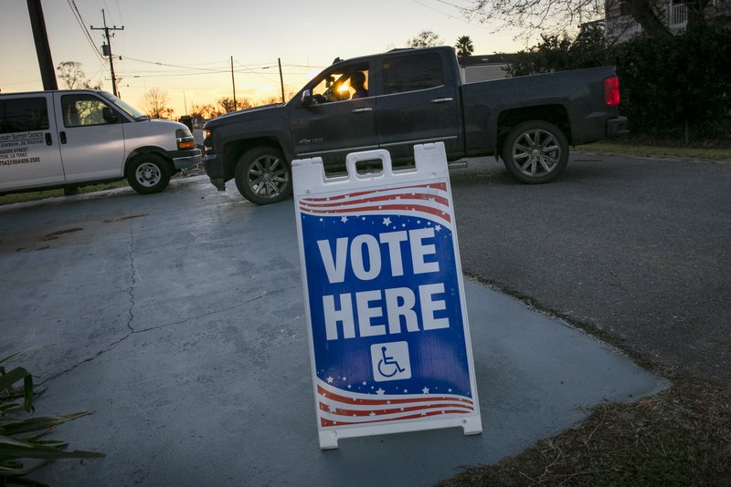 The sunsets as people arrive to vote at St. Paul Missionary Baptist Church in Ironton, Louisiana for Election Day on Tuesday, Nov. 3, 2020. (Chris Granger/The Advocate via AP)