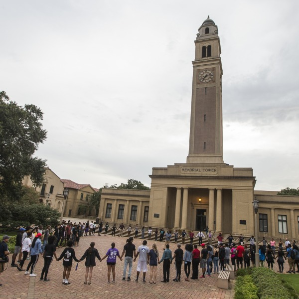 BATON ROUGE, LA -JULY 11: Students gather at a prayer vigil for Alton Sterling at the Memorial Tower on the Louisiana State University campus July 11, 2016 in Baton Rouge, Louisiana. Sterling was shot by a police officer in front of the Triple S Food Mart in Baton Rouge on July 5th, leading the Department of Justice to open a civil rights investigation. (Photo by Mark Wallheiser/Getty Images)