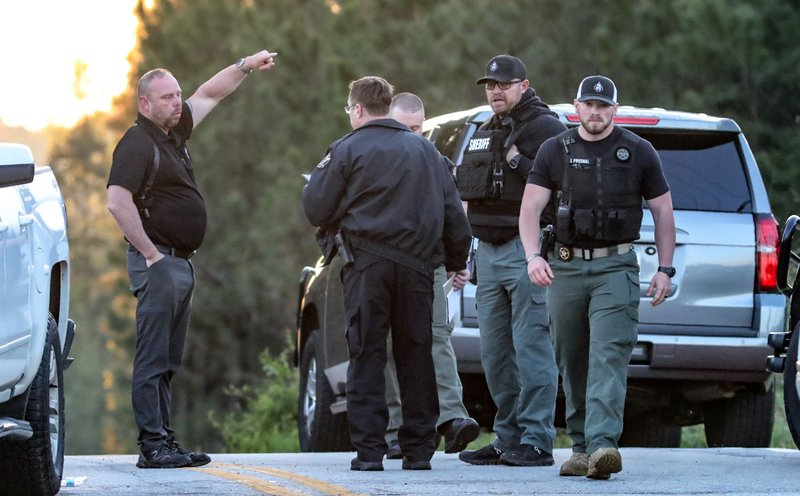 Law enforcement work the scene scene following a police chase Monday, April 12, 2021, in Carroll County, Ga. Georgia authorities say multiple officers were injured when the passenger of a car shot them during a police chase that ended with one suspect killed and the other arrested. (John Spink/Atlanta Journal-Constitution via AP)