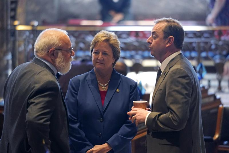 Bret Allain, R-Franklin, left, chairman of the Senate Revenue and Fiscal Affairs Committee, talks with Sen. Sharon Hewitt,R-Slidell, and Sen. Patrick McMath, R-Covington, during opening day of the Louisiana legislative session in Baton Rouge, La., Monday, April 12, 2021. (AP Photo/Gerald Herbert)