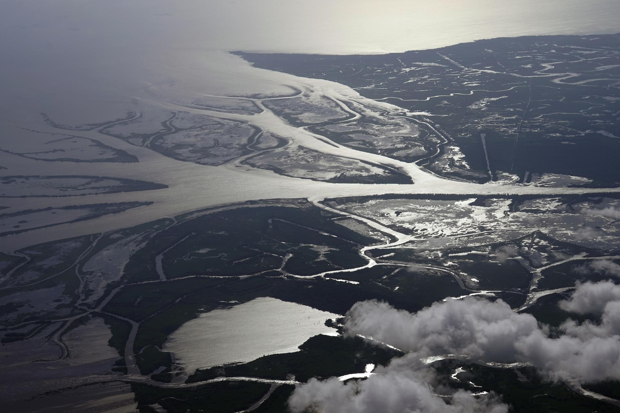 The Wax Lake Delta in the Atchafalaya Basin is seen from 8,500 feet in St. Mary Parish, La., Tuesday, May 25, 2021. (AP Photo/Gerald Herbert)