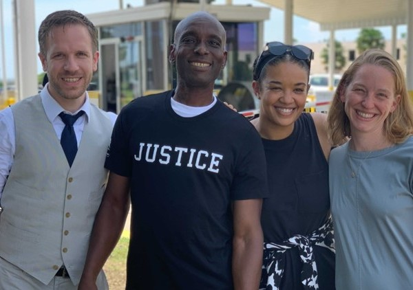 Kaliegh with his legal team - from left: Richard Davis, Kaliegh Smith, Kiah Howard and Meredith Angelson. (Credit: Innocence Project)