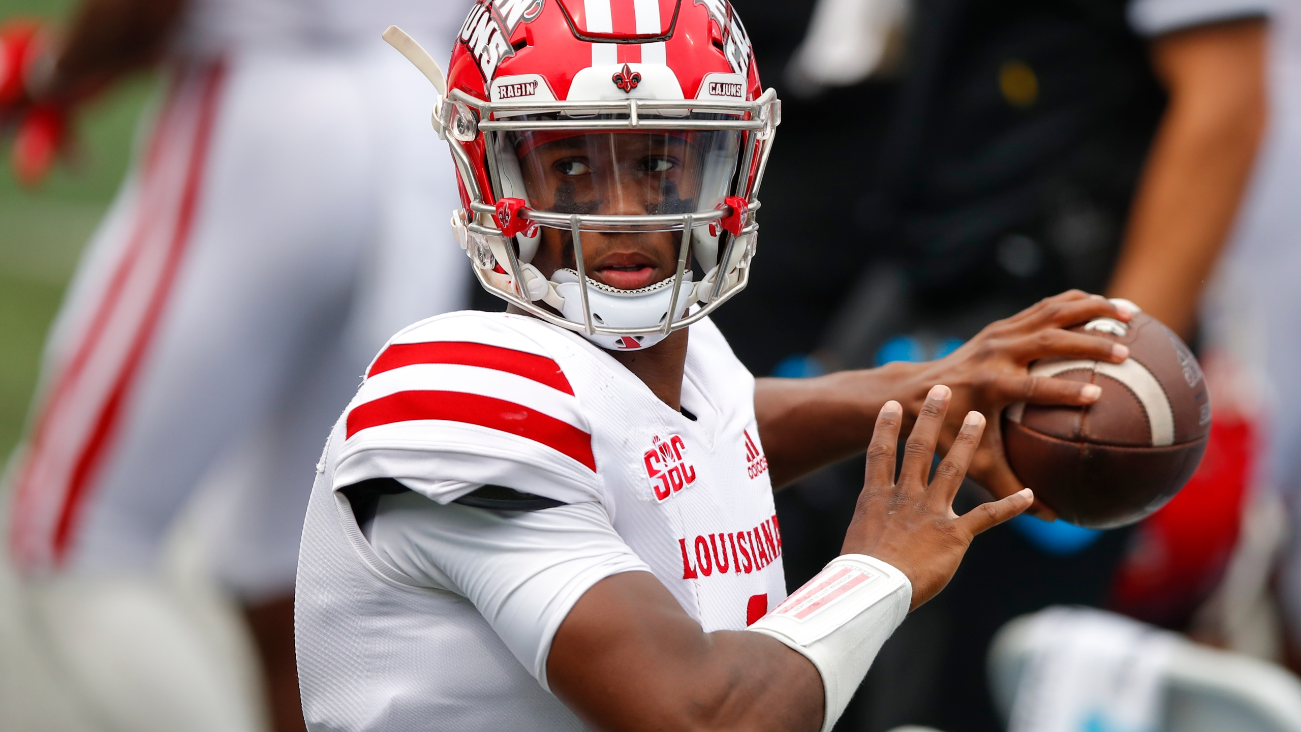 ATLANTA, GA - SEPTEMBER 19: Levi Lewis #1 of the Louisiana-Lafayette Ragin Cajuns warms up on the sideline during the second half against the Georgia State Panthers at Center Parc Stadium on September 19, 2020 in Atlanta, Georgia. (Photo by Todd Kirkland/Getty Images)