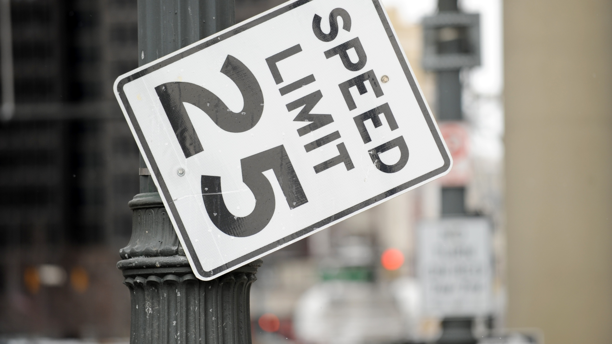 A speed limit sign that is tilting due to a broken bolt January 12, 2011 in Detroit, Michigan. AFP PHOTO/Stan HONDA (Photo by STAN HONDA / AFP) (Photo by STAN HONDA/AFP via Getty Images)