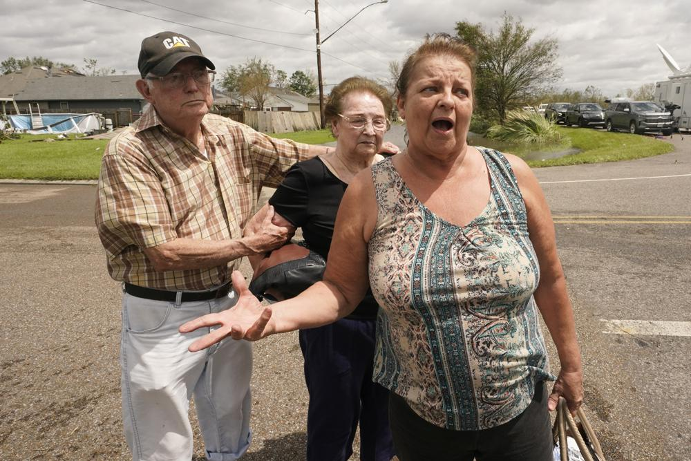 Residents of the Spring Meadow subdivision, Debbie Greco, and her parents Fred Carmouche, and his wife Faye, talk to the media after being helped out of their flood ed home on a boat after Hurricane Ida moved through Monday, Aug. 30, 2021, in LaPlace, La. (AP Photo/Steve Helber)