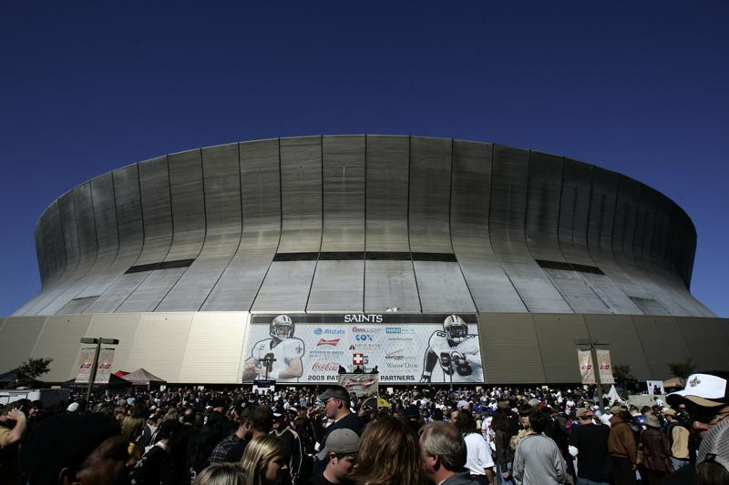 FILE - Fans arrive at the Louisiana Superdome before an NFL football game between the New Orleans Saints and the New York Giants in New Orleans, in this Sunday, Oct. 18, 2009, file photo. Amid public and political scrutiny, the New Orleans Saints have adopted a new refund policy allowing fans to relinquish their season tickets and get their money back. (AP Photo/Patrick Semansky, File)