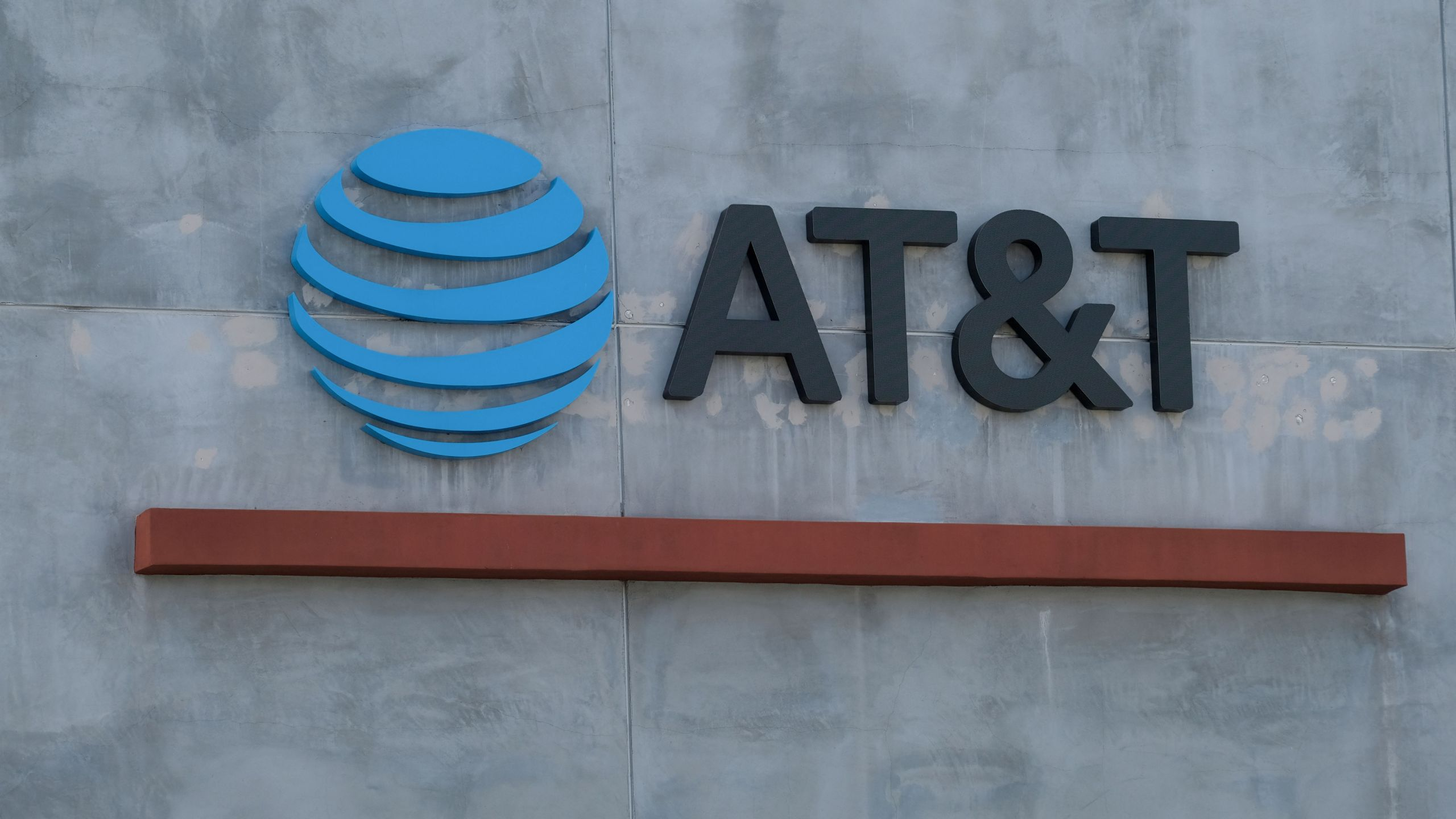 The AT&T logo sign is seen above the store in Culver City, California on January 28, 2021. - US telecommunications firm AT&T announced on May 17, 2021 a merger between its WarnerMedia unit -- which owns CNN and HBO -- and Discovery media, creating a streaming giant that could compete with Netflix and Disney+. When the deal is finalized, AT&T will receive $43 billion and AT&T's shareholders will take stock representing 71 percent of the new company, with Discovery shareholders owning 29 percent. (Photo by Chris DELMAS / AFP) (Photo by CHRIS DELMAS/AFP via Getty Images)