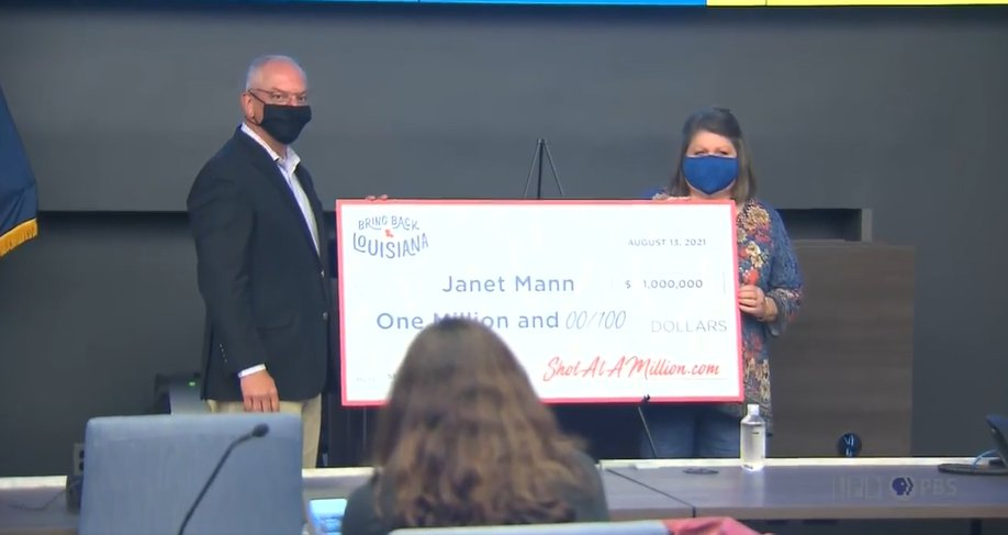 Gov. John Bel Edwards awards Janet Mann with $1 million.